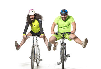 Photo sur Plexiglas Artiste KB Plump and skinny guys riding bicycles