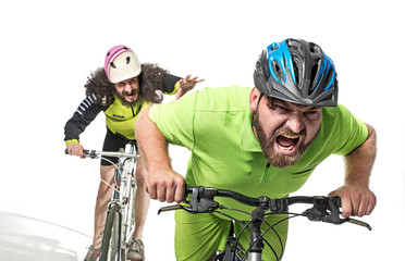 Plump and skinny guys riding bicycles