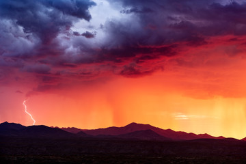 Tuinposter Aubergine Sunset with monsoon storm clouds in the Arizona desert