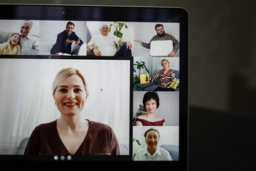Fototapeta Businesswoman Video Conferencing With Happy Colleagues On Computer In Office obraz
