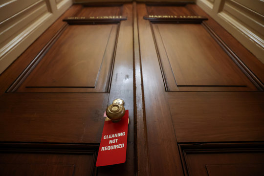 A tag for cleaning crews hangs on McConnell's office doors in the mostly empty U.S. Capitol during the coronavirus disease (COVID-19) outbreak in Washington