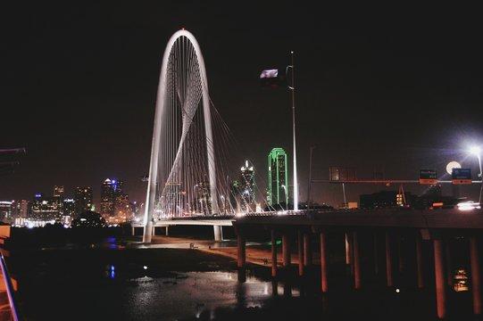 Illuminated Margaret Hunt Hill Bridge Over River At Night