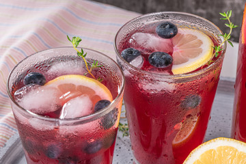 Fresh blueberry summer mojito cocktail. Blueberry lemonade or sangria on kitchen countertop