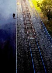 Spoed Fotobehang Spoorlijn High Angle View Of Man Walking On Street By Railroad Track