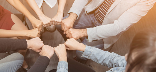 Creative team meeting fist bumps circle, hands together, asian people teamwork acquisition, brainstorm business people concept. Startup friends creative people sale project panoramic banner