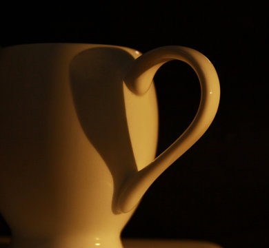 Shadow Of Coffee Cup Handle Forming Heart Shape