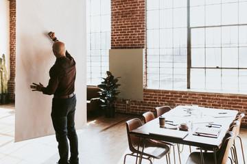 Businessman writing on a presentation poster