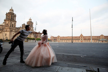 A girl prepares to have her quinceanera pictures taken in Zocalo Square amid the outbreak of the coronavirus disease (COVID-19), in Mexico City