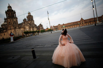 A girl has her quinceanera pictures taken in Zocalo Square amid the outbreak of the coronavirus disease (COVID-19), in Mexico City