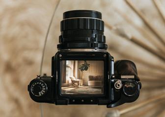 Living room interior through the lens of an analog camera