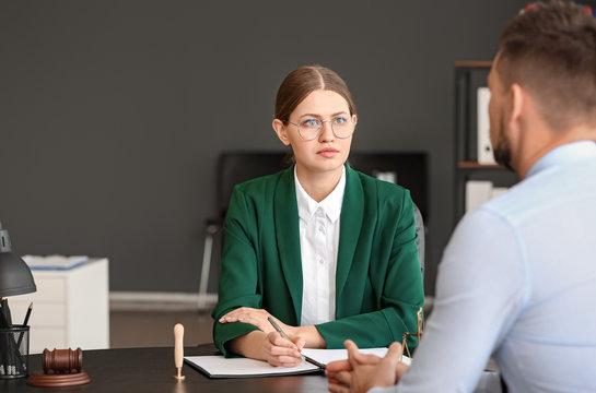 Female judge working with client in office