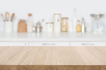 Tabletop over blurred kitchen with copy space for your composition Wall mural