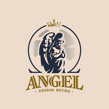 Angel child prays standing on his knee.