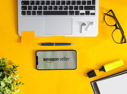 Amazon seller shopping application icon on Apple iPhone X screen close-up. Amazon shopping app icon. Amazon mobile application. Social media network
