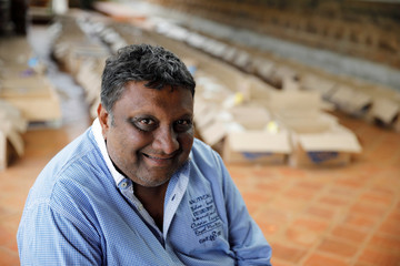 Pankaj Shah, founder of the Team Pankaj aid group, poses for a picture near boxes with food donations to be distributed for people in need in the capital's poorest neighbourhoods, in Nairobi