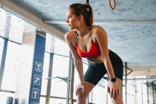 Portrait of athletic sportswoman doing exercise while working out