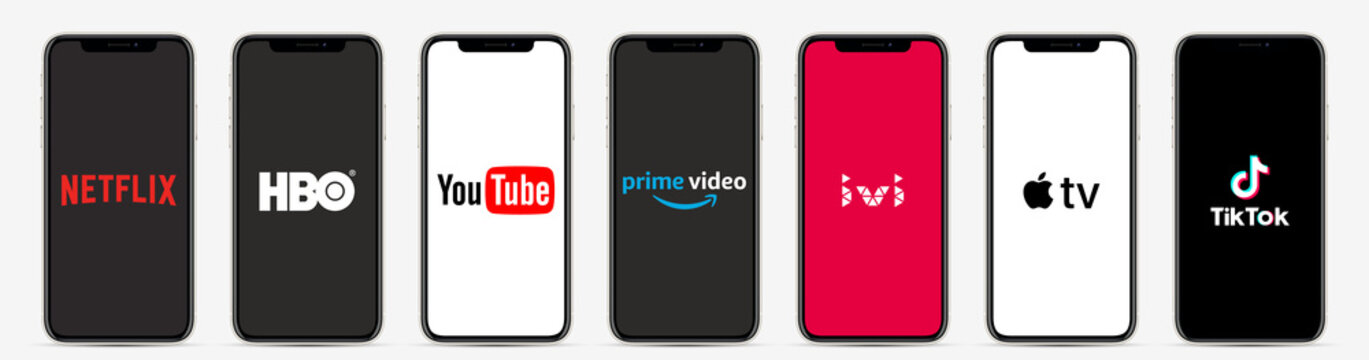 MOSCOW, RUSSIA - APRIL 16, 2020: smarphones with different popular cinema and video application: Netflix, HBO, YouTube, IVI, Amazon prime video, apple tv, TikTok