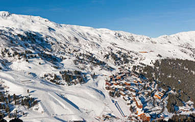 Wall Mural - Panoramic view down a mountain valley over ski resort