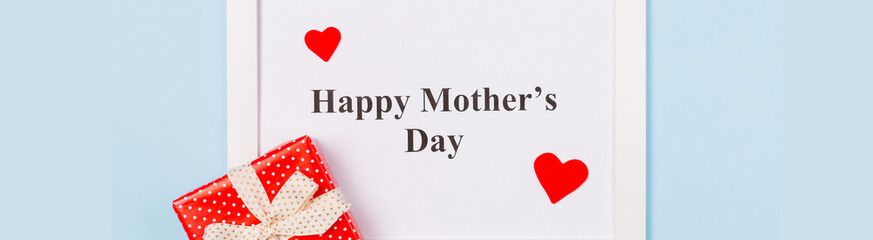 Banner White picture frame with text Happy Mother's Day and red heart on light blue background . Happy Mother's Day concept.