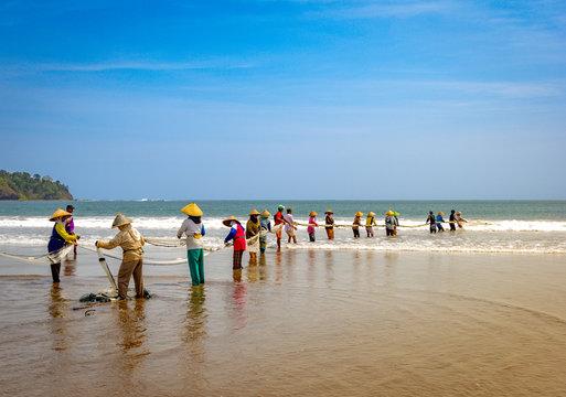 Traditional fishing on Pangandaran beach in Indonesia