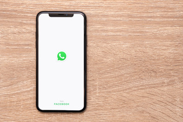 BANGKOK,THAILAND-APRIL 16: View of Whatsapp Messenger Application by Facebook on Iphone Screen on the Wooden Table on April 16,2020