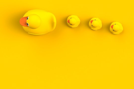 Close up of mum and baby rubber ducks isolated. Bath toys on a yellow background. Top view with copy space. Summer wallpaper. 3d rendering.
