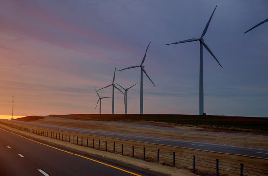 Wind generators at sunset a Texas ranch
