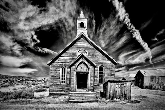Grayscale shot of an old abandoned church at Bodie State Historic Park in California