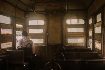 A passenger sitting in a Tram in Kolkata, West Bengal, India.  Papier Peint