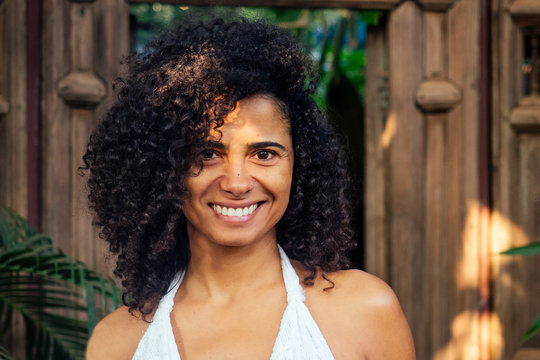 natural beautiful mixed race woman without makeup in tropical gerden park