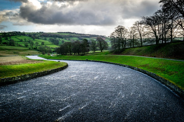 Fototapeten Grau Surface Level Of Road Along Countryside Landscape