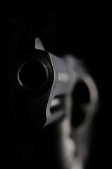 Close-up Of Gun Over Black Background - fototapety na wymiar