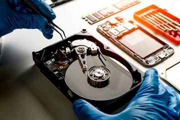 Fototapeta data hard drive backup disc hdd disk restoration restore recovery engineer work tool virus access file fixing failed profession engineering maintenance repairman technology concept obraz