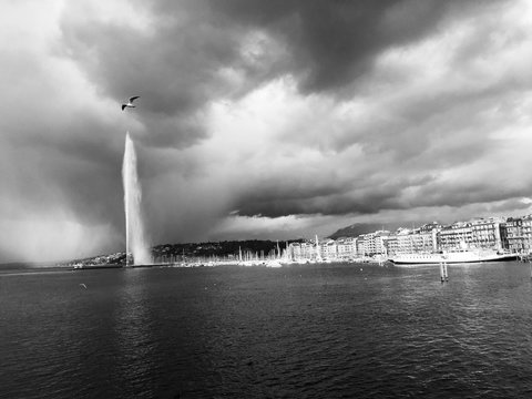 View Of Jet Deau In Lake Geneva Against Cloudy Sky