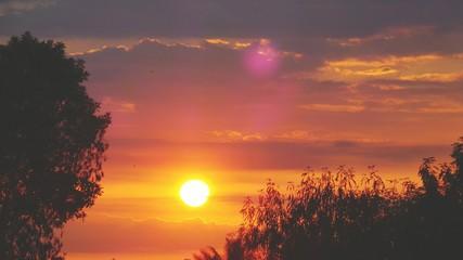 Foto auf AluDibond Rotglühen Silhouette Of Landscape Against Cloudy Sky At Sunset