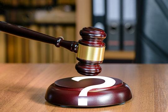 Judgment is in doubt. Court decision is marked by a question mark. Judicial gavel and question mark, concept of court and law. Who is right and who is guilty?