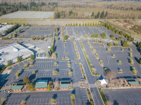 Aerial image of the abandoned parking lot at an outlet mall due to the coronavirus stay home order