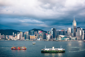 Wall Mural - Panorama of Hong Kong City skyline from across Victoria Harbor; with Sunlight effect