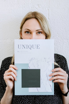 Woman holding a magazine