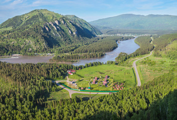 Wall Mural - View of the Katun river valley, Altai. Sunny day in early summer. Travel and vacation in the mountains.