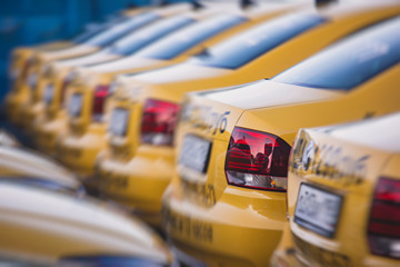 View of yellow taxi cab parking lot with yellow cars standing, set of taxicabs in the streets, taxis
