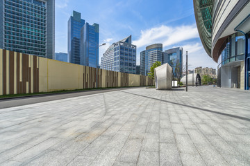 Fotomurales - empty pavement and modern buildings in city.