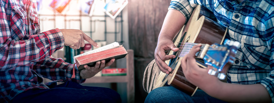 Young christian reading Bible and worship God, Christian worship concept.