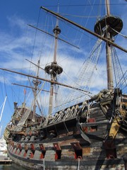 Old Ship Moored At Harbor Against Sky