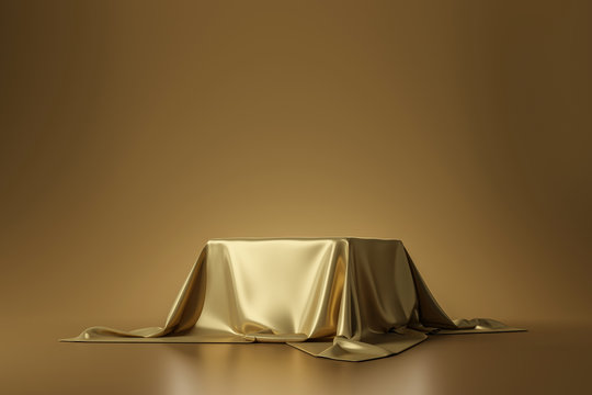 Golden luxurious fabric placed on top pedestal or blank podium shelf on gold background with luxury concept. 3D rendering.