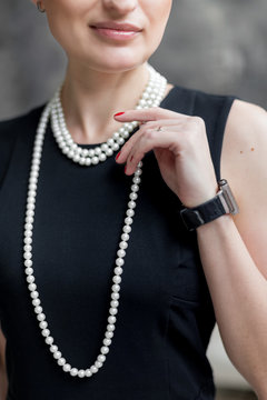 Business woman wearing pearl necklace