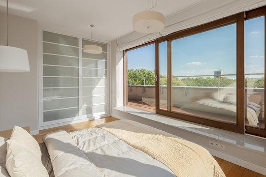 Elegant bedroom with window wall