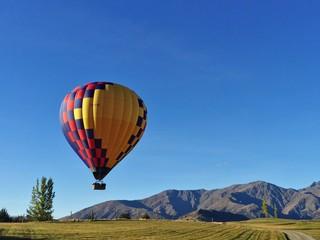 Hot Air Balloon Flying Against Clear Blue Sky