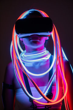 futuristic african american woman in vr headset and neon lighting