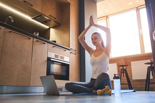 Female yogi streaming a live video to her followers